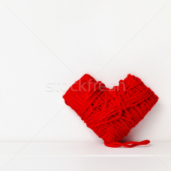 heart-shaped coil of red yarn Stock photo © nito