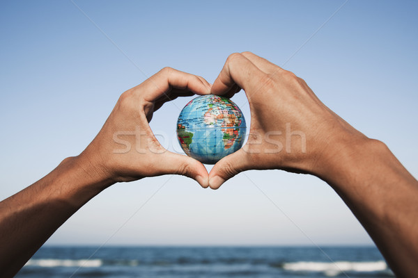 young man with a world globe in his hands  Stock photo © nito