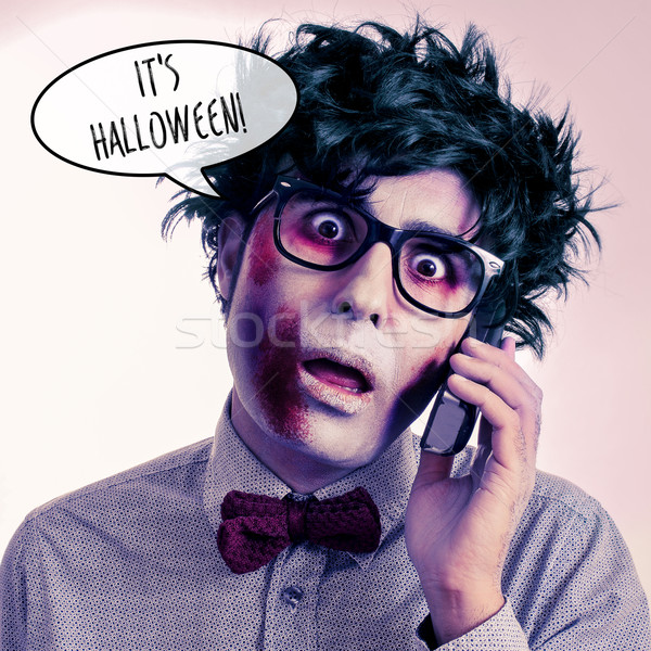 hipster zombie on the phone says it is Halloween Stock photo © nito