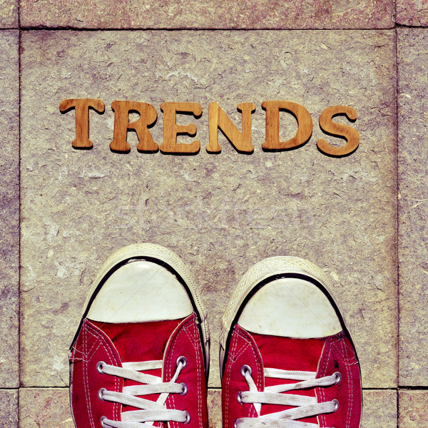 wooden letters forming the word trends and the feet of a young m Stock photo © nito
