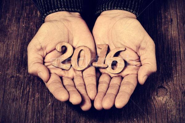 Stock photo: number 2016, as the new year, in the hands of a man