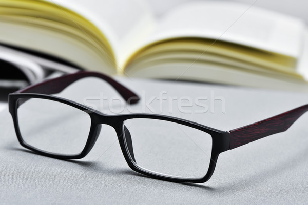 eyeglasses and open book Stock photo © nito