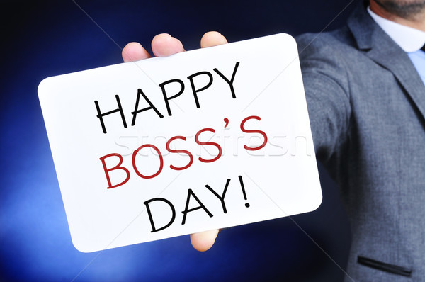man with a signboard with the text happy boss day Stock photo © nito