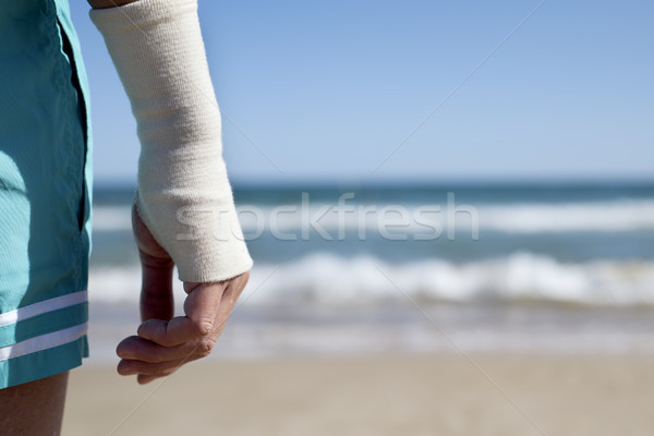 man on the beach with a bandage in his wrist Stock photo © nito