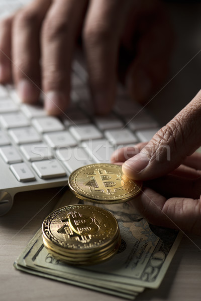 dollar bills, bitcoins and man using a computer Stock photo © nito
