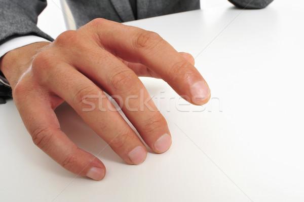 Mann Anzug Finger tragen Sitzung Schreibtisch Stock foto © nito