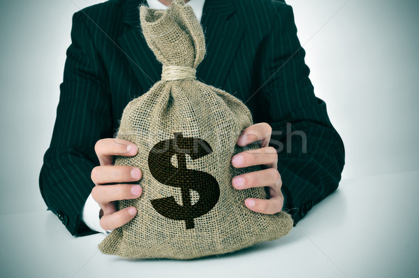 man in suit with a burlap money bag Stock photo © nito