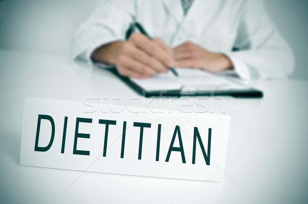 Dietista médico sessão secretária palavra escrito Foto stock © nito