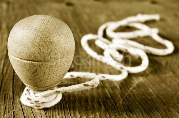 wooden spinning top with a string coiled in its axis, in sepia t Stock photo © nito