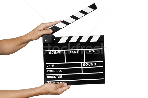 young man with a traditional wooden clapperboard Stock photo © nito