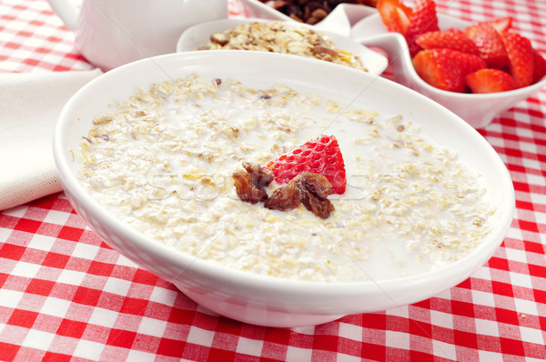 bowl with porridge on a set table for breakfast Stock photo © nito