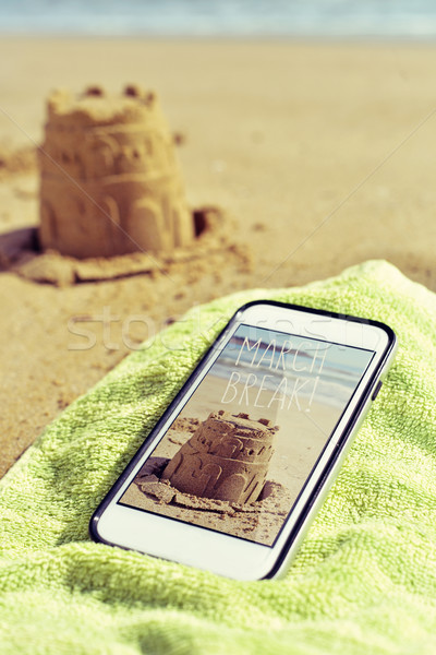 picture of a sandcastle and text march break in a smartphone Stock photo © nito