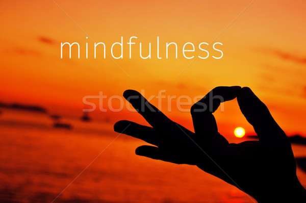 text mindfulness and hand in gyan mudra at sunset Stock photo © nito