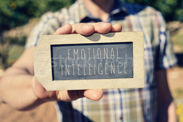 man with a chalkboard with the text emotional intelligence Stock photo © nito