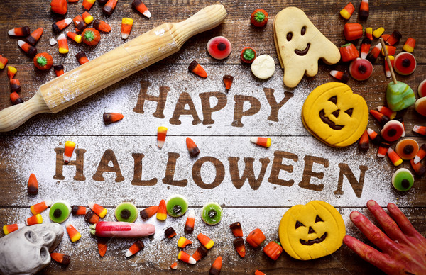 Stock photo: candies, cookies and text Happy Halloween