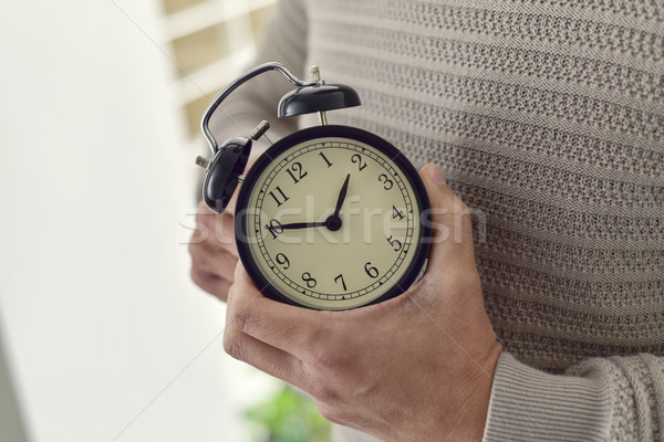 man winding or adjusting the time of a clock Stock photo © nito