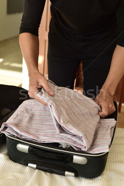 young caucasian man packing or unpacking Stock photo © nito