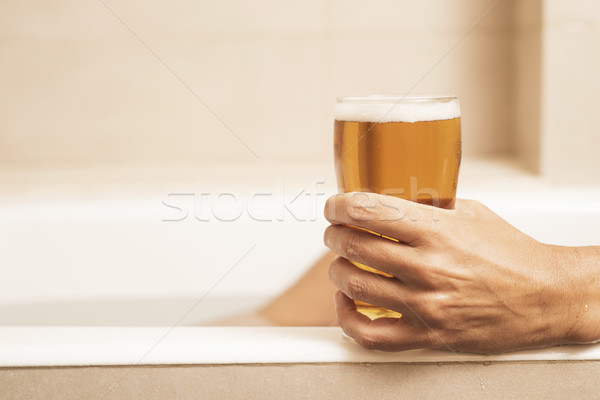 young man drinking a beer on the bathtub Stock photo © nito