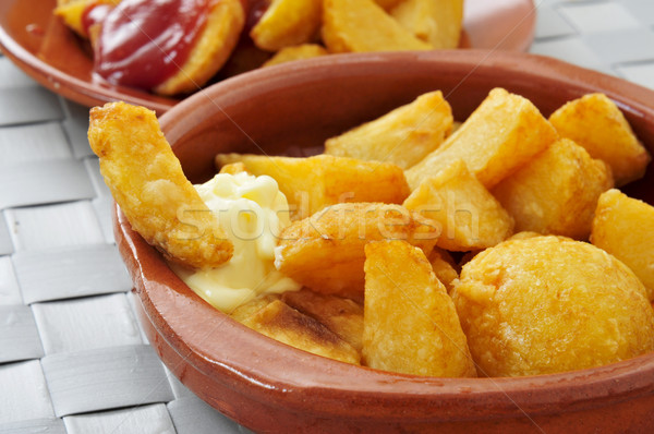 typical spanish patatas bravas, fried potatoes with a hot sauce Stock photo © nito