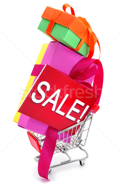 gifts and a signboard with the word sale in a shopping cart Stock photo © nito