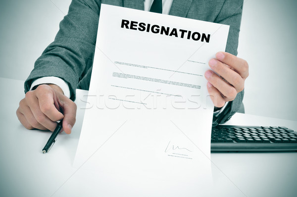man in suit showing a figured signed resignation document Stock photo © nito