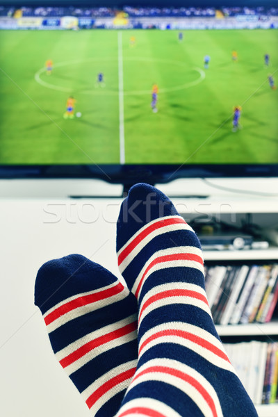 man watching a soccer match in the TV Stock photo © nito