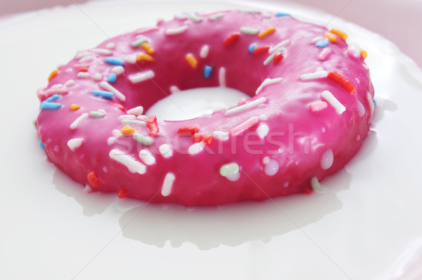 pink donut being soaked in milk Stock photo © nito
