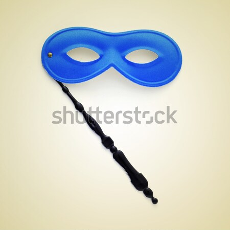 young man holding a carnival mask Stock photo © nito