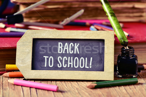 text back to school in a label-shaped chalkboard Stock photo © nito
