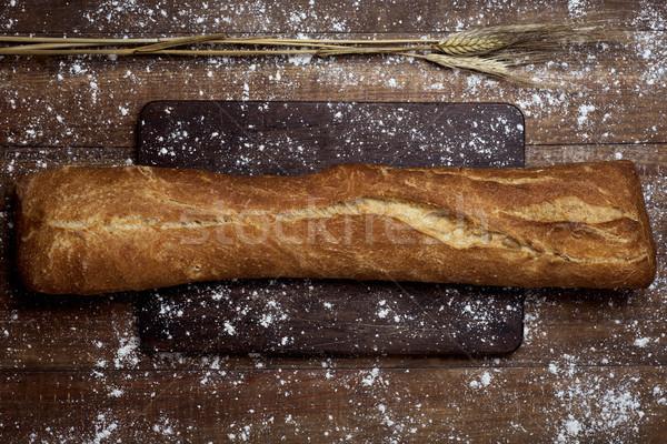Ekmek tipik atış somun rustik ahşap masa Stok fotoğraf © nito
