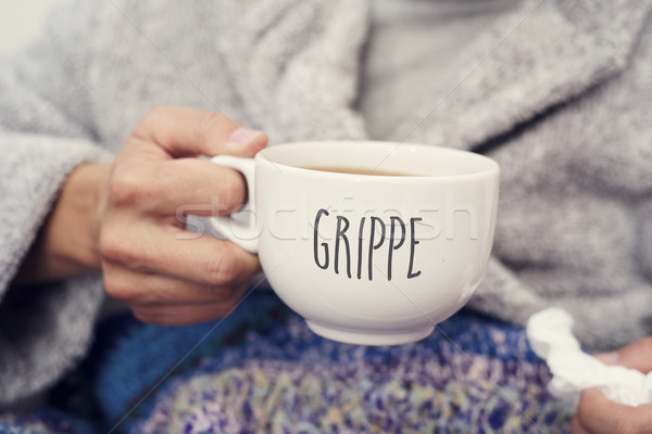 ill man and mug with word grippe, flu in french Stock photo © nito