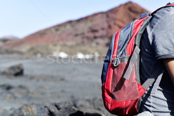 young man hiking in a volcanic landscape Stock photo © nito