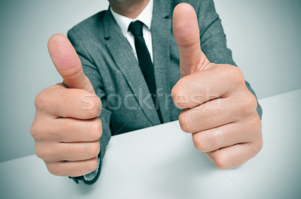 Férfi öltöny remek jel visel ül Stock fotó © nito