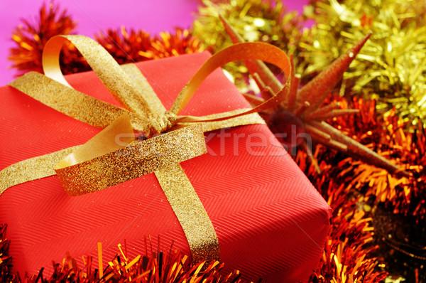 Karácsony ajándék piros csomagolópapír arany szalag Stock fotó © nito