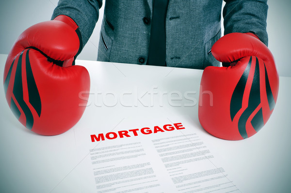 man in suit with boxing gloves and a mortgage contract Stock photo © nito