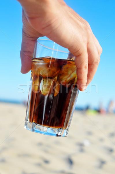 Cola drinken strand hand jonge man Stockfoto © nito