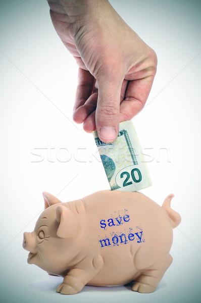 Megtakarítás valaki bemutat 20 dollár bankjegy Stock fotó © nito