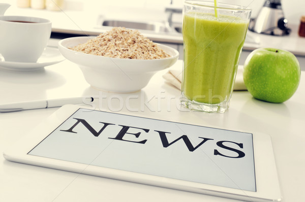 breakfast and news at the kitchen table Stock photo © nito