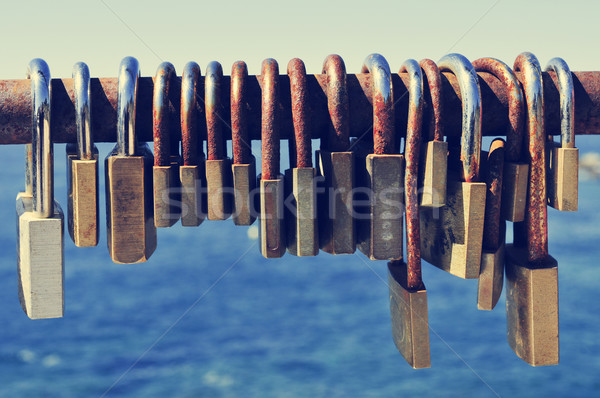 rusty padlocks on a railing near the sea Stock photo © nito