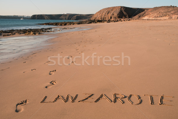 word lanzarote carved in the sand of a beach Stock photo © nito