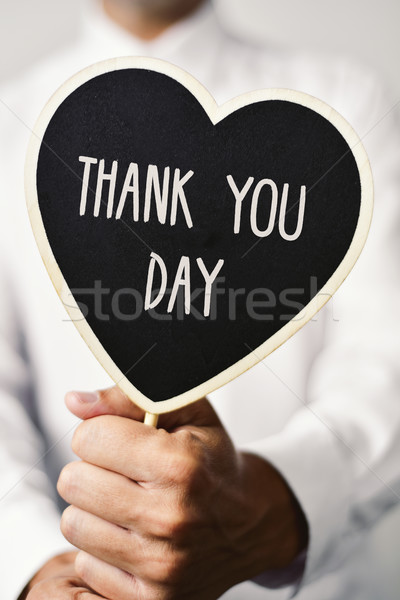 man with signboard with the text thank you day Stock photo © nito