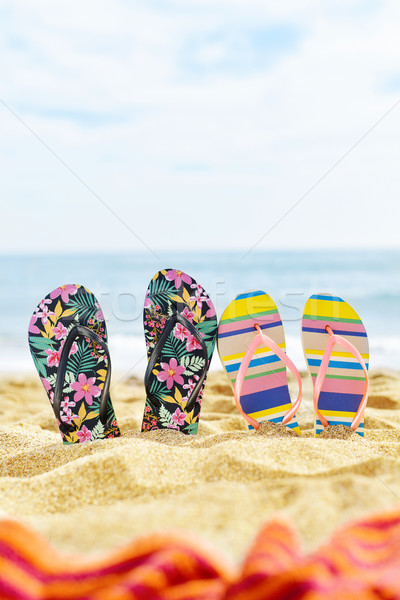 two pair of flip-flops on the beach Stock photo © nito