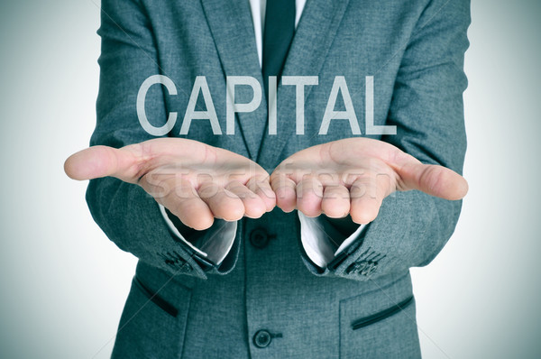 capital in a businessman hands Stock photo © nito