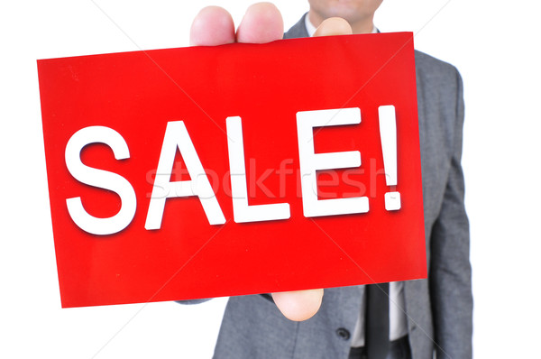 man in suit with a signboard with the text sale Stock photo © nito