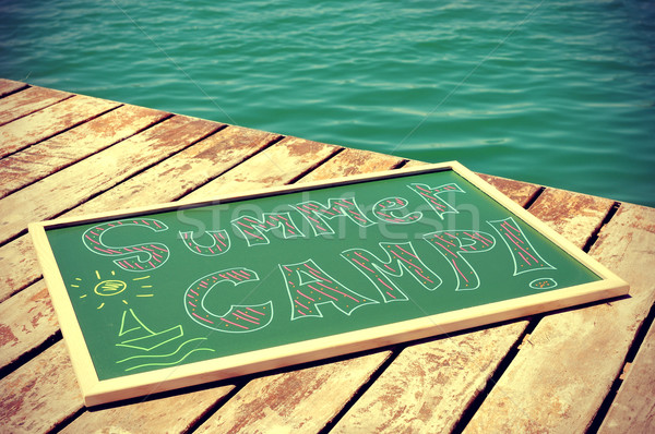 text summer camp written in a chalkboard, slight vignette added Stock photo © nito