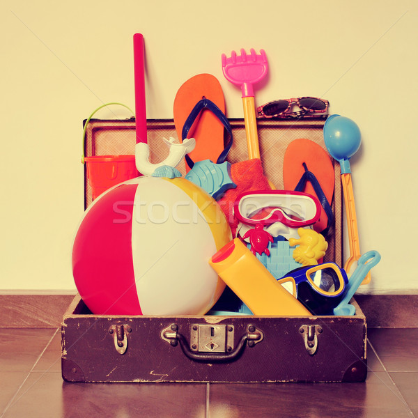old cardboard suitcase full of beach items, with a retro effect Stock photo © nito