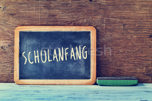 Stock photo: text schulanfang, back to school in german, written on a chalkbo