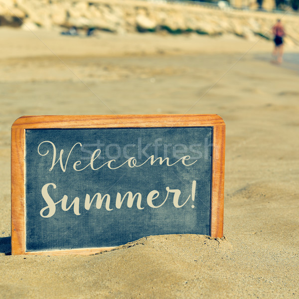 text welcome summer in a chalkboard, on the sand of a beach Stock photo © nito