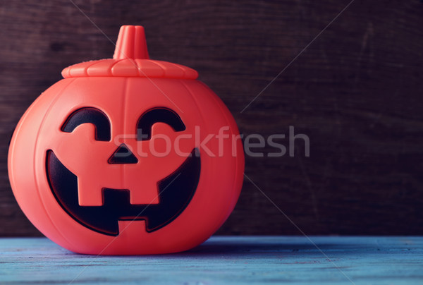Halloween pumpkin on a blue wooden surface Stock photo © nito