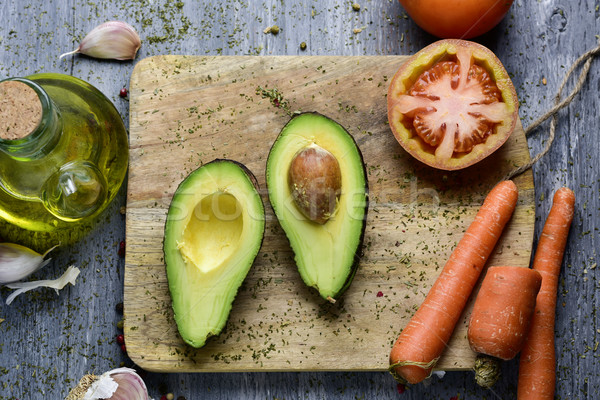 avocado, tomato, carrot, garlic and olive oil Stock photo © nito